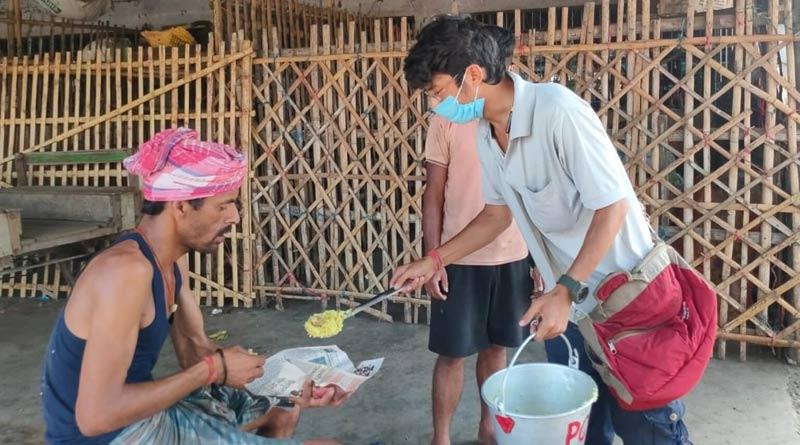 Migrant labourer served street dogs' food at Japlaiguri, controversy arises | Sangbad Pratidin