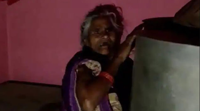 Scared of Covid vaccine, elderly woman in UP's Etawah hides behind a drum, video goes Viral   Sangbad Pratidin