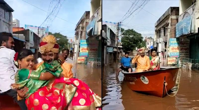 Bride and groom on boat in flooded Sangli, Maharashtra | Sangbad Pratidin