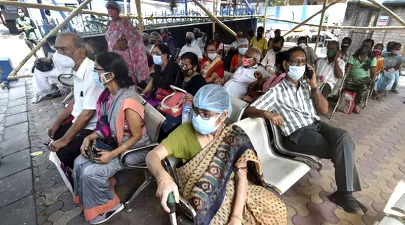Chaos in canning in que of COVID vaccine, 2 injured | Sangbad Pratidin