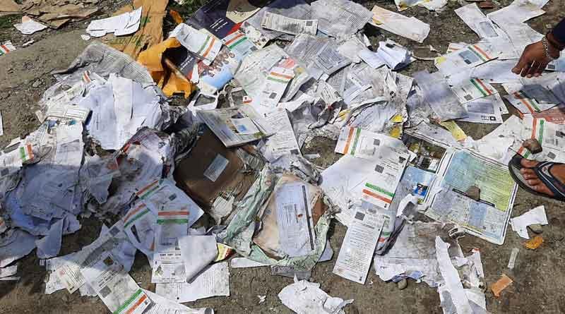 Aadhaar card recovers from dumping area in Siliguri । Sangbad Pratidin
