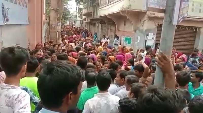 Stampede at Birbhum as crowed storm 'Lakshmir Bhandar' form distribution centre | Sangbad Pratidin