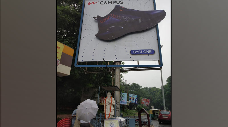 Advertisement of shoes on the statue of Rabindranath Tegore, sparks controversy   Sangbad Pratidin