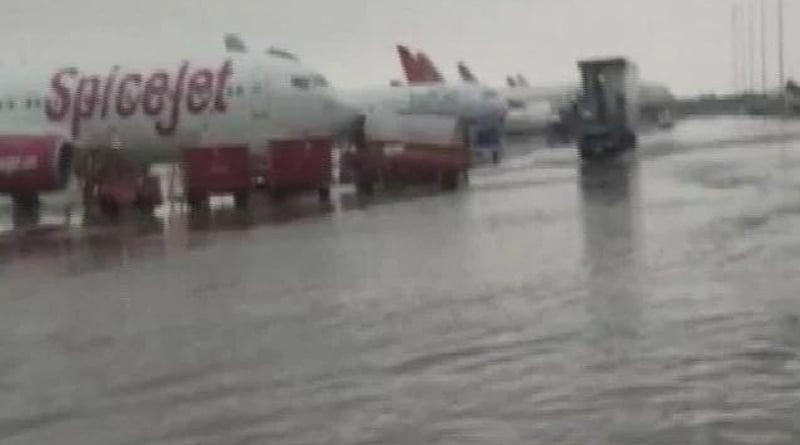 Delhi airport flooded after record rain, city on orange alert। Sangbad Pratidin