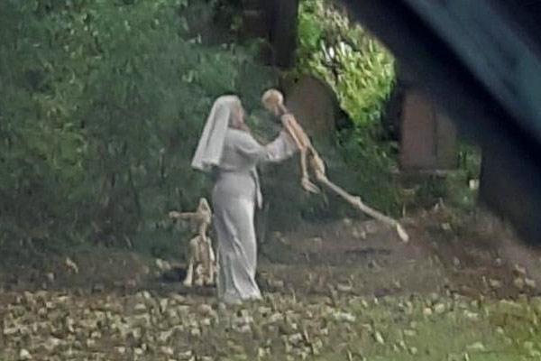 Nun dances with skeleton