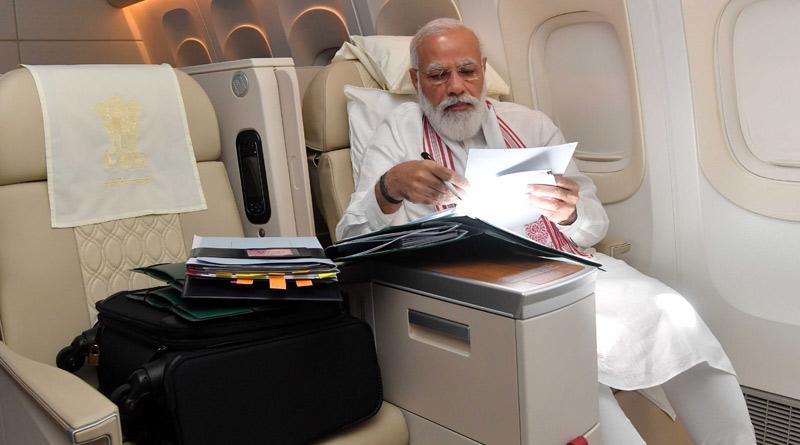 PM Modi on board Air India one, shares photo। Sangbad Pratidin