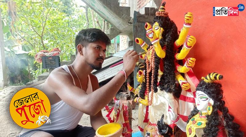 MA student makes Durga idol in Jalpaiguri | Sangbad Pratidin