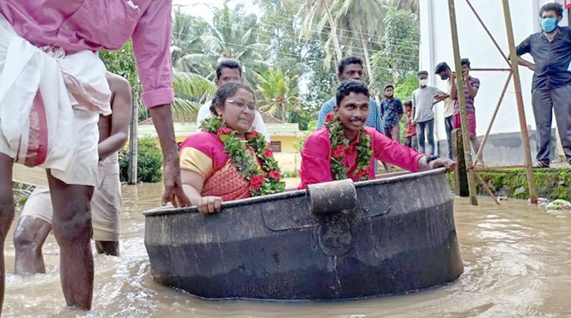 Kerala Couple converted a large aluminum cooking vessel into a boat to reach their wedding venue | Sangbad Pratidin