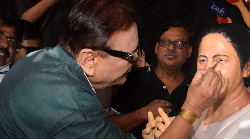 Madan Mitra draws eye of Durga idol based on Mamata Banerjee । Sangbad Pratidin