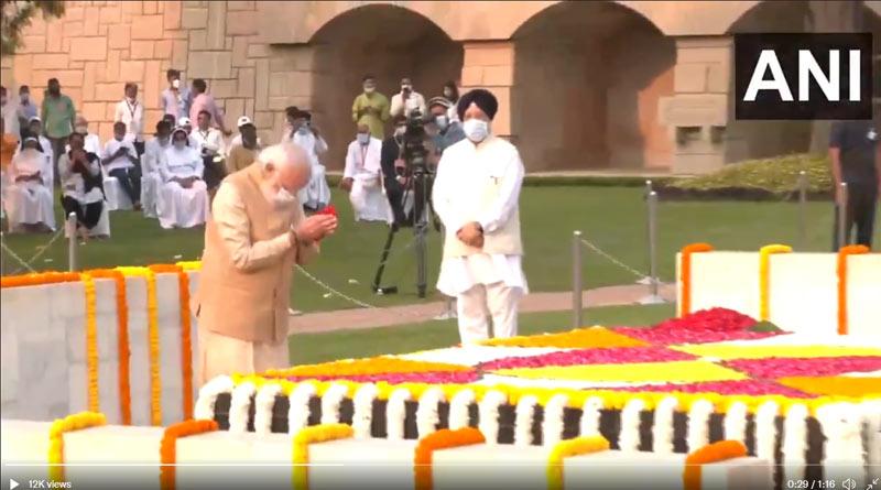 Prime Minister Narendra Modi pays floral tributes to Mahatma Gandhi at Rajghat | Sangbad Pratidin