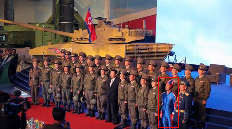 Pic of soldier wearing super-tight blue outfit while posing with Kim Jong-un goes viral। Sangbad Pratidin